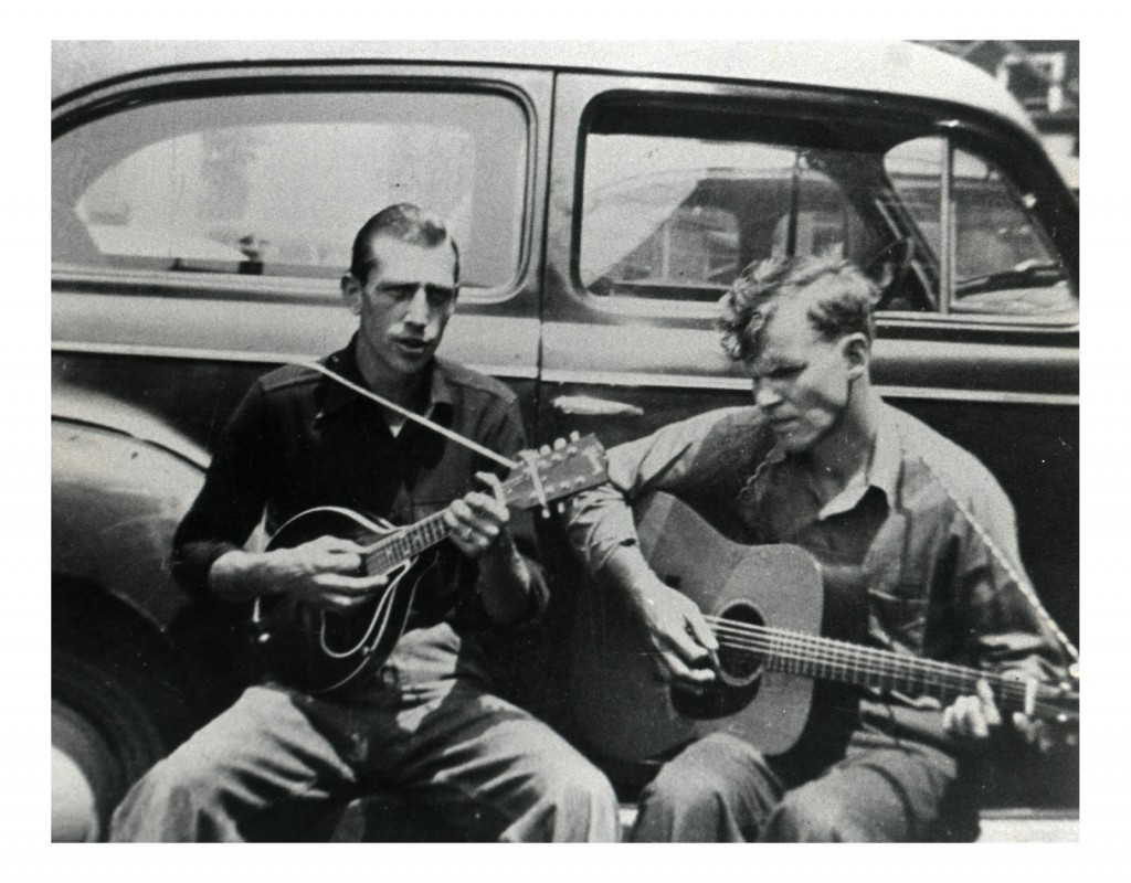 """Doc Watson and Clarence """"Frog"""" Greene playing in the streets of Boone, NC in the 1950's."""